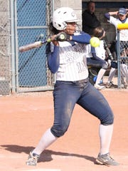 Silver's Daeza Morales takes this ball off the forearm as she bats against Alamogordo on Tuesday.
