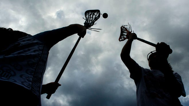 Girls lacrosse players demonstrate a draw control during practice on Thursday.