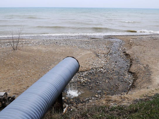 Water flows from a drain along Lake Huron in Worth
