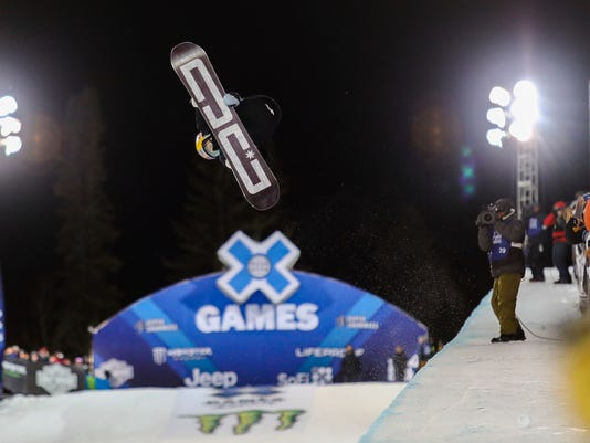 Toby Miller flies by the crowd during the Men's Snowboard Superpipe Finals during the X Games on Sunday, Jan. 28, in Aspen, Colo. (Chris Dillmann/Vail Daily via AP)