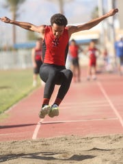 Palm Springs High School's Jordan Truitt competes in the long jump at Indio High School during a track meet Thursday. J. Omar Ornelas/ The Desert Sun