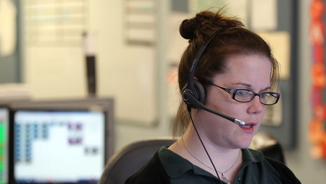 Amanda Allen, a Kenton County 911 dispatcher, works in the Kenton County Emergency Communications Center in Independence.