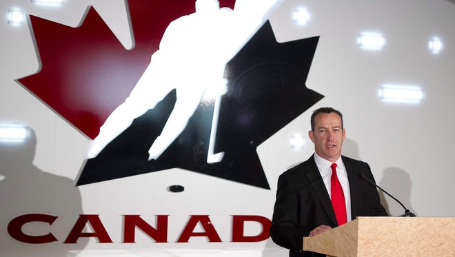 Kevin Dineen speaks during a news conference where he was introduced as the new head coach of Canada's national women's hockey team.