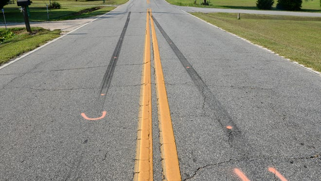 Skid marks and paint mark Flat Rock Road in Starr, where George Eugene Williams, 73, of Iva was struck Monday.