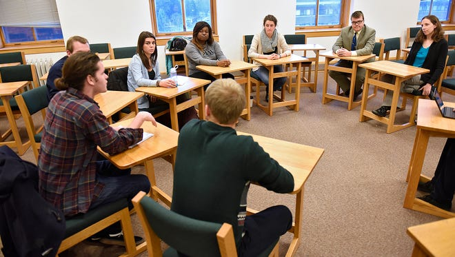 Students gather Thursday at St. John's University to discuss their experiences during the COP21 United Nations conference on climate change in Paris.