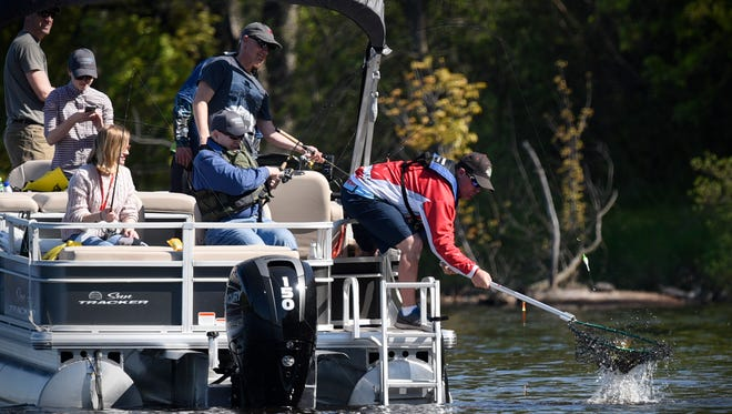 Gov. Mark Dayton catches a fish during the 2017 Governor's Fishing Opener Saturday, May 13, on the Mississippi River in St. Cloud.