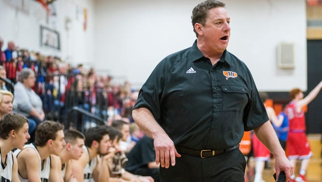 Marine City basketball coach Ron Glodich shouts to the team during the MHSAA Class B District Semifinals against St. Clair High School at Marine City High School March 7.