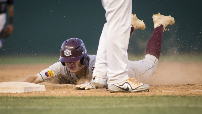 Tate Childers (22) of the Mountain Ridge Mountain Lions slides in safe at third base against the Sandra Day O'Connor Eagles at Brazell Field at Grand Canyon University on Thursday, April 19, 2018 in Phoenix, Arizona.