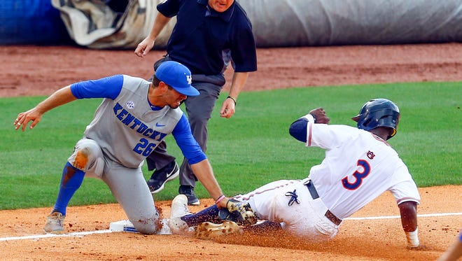 Auburn infielder Josh Anthony (3) is tagged out by Kentucky infielder Luke Heyer (26) as he slides into third base during the third inning of a Southeastern Conference NCAA college baseball game, Tuesday, May 22, 2018, in Hoover, Ala. (AP Photo/Butch Dill)