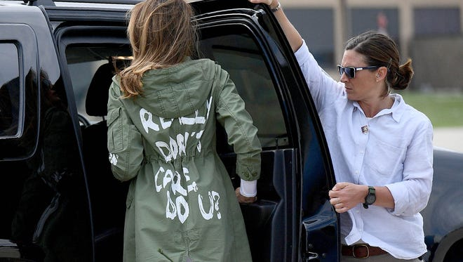 "First Lady Melania Trump departs Andrews Air Rorce Base in Maryland June 21, 2018 wearing a jacket emblazoned with the words ""I really don't care, do you?"" following her surprise visit with child migrants on the US-Mexico border."