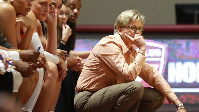 Tennessee head coach Holly Warlick watches her team from the bench in the second half of Sunday's game in Blacksburg Va.