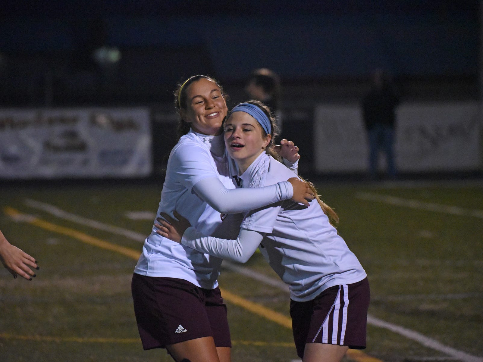 Windsor High School girls soccer players Leticia Oliva, left, and Bailey Zehr hug while celebrating a goal in a game earlier this season. The Wizards beat Battle Mountain 1-0 on Thursday to advance to the semifinals of the Class 4A state playoffs.
