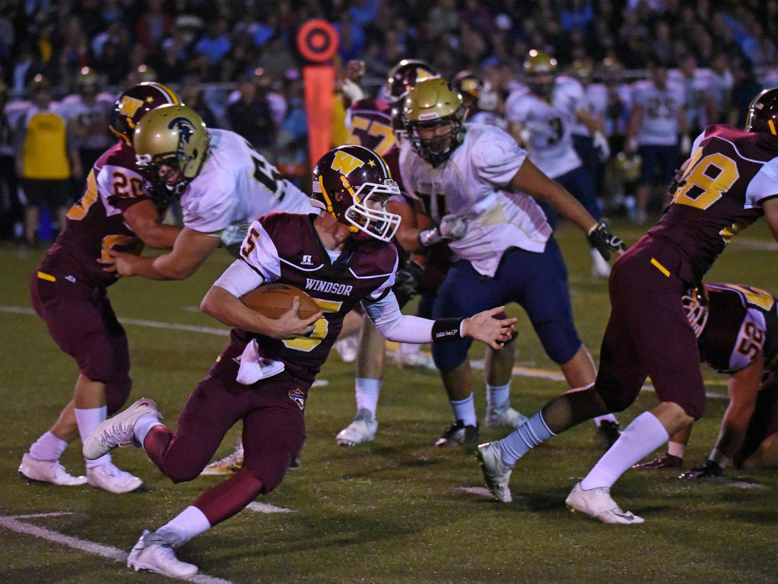 Windsor quarterback Brad Peeples is shown during the Wizards' game against Greeley West last week. Windsor will play at Longmont at 7 p.m. Thursday.