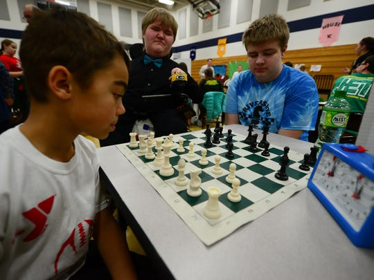DCE Chess Club contemplates their next move.