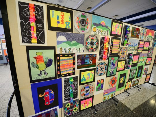 Wall of student art displayed during IMAGINE.