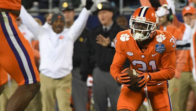 Clemson defensive back Ryan Carter (31) intercepts a ball against Miami during the first quarter of the Dr. Pepper ACC Football Championship Game in Charlotte, North Carolina.