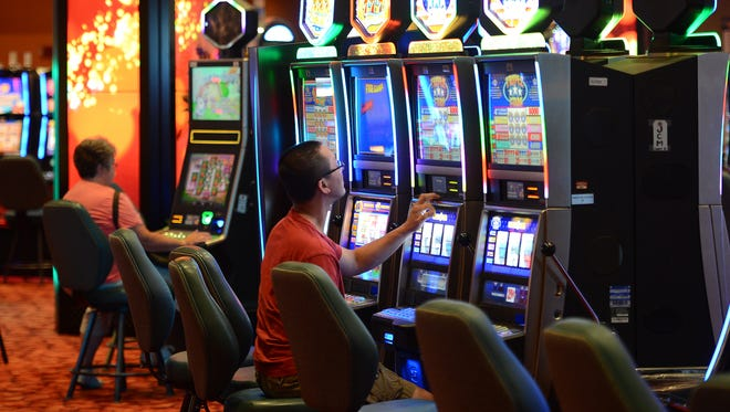Guests play the slot machines in a smoke-free room at the Oneida Casino.