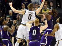 Mar 20, 2016; Brooklyn, NY, USA; Notre Dame Fighting Irish guard Rex Pflueger (0) tips in the winning basket against the Stephen F. Austin Lumberjacks during the second half in the second round of the 2016 NCAA Tournament at Barclays Center. Mandatory Credit: Robert Deutsch-USA TODAY Sports