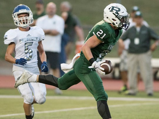 Northern Valley Regional High School Demarest at Ramapo High School on Friday, September 15, 2017. R #21 Shane Brancaleone scores a touchdown in the first quarter.