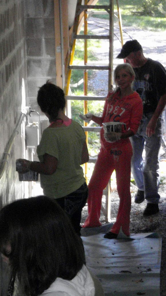 Painting the train tunnel (provided photo)