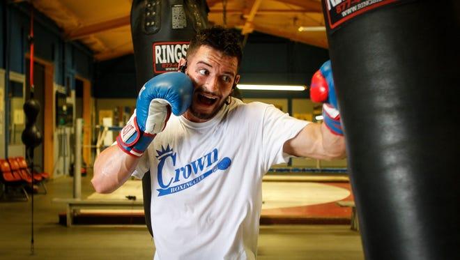 Justin Johnson, 20, of East Lansing, works out Aug. 3, 2017, at Crown Boxing Club in Lansing.  [Matthew Dae Smith/Lansing State Journal]
