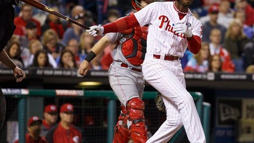 Philadelphia Phillies' Domonic Brown hits a double to score Ryan Howard, Marlon Byrd, and Cody Asche during the seventh inning of a baseball game against the Cincinnati Reds, Saturday, May 17, 2014, in Philadelphia. The Phillies win 12-1. (AP Photo/Chris Szagola)
