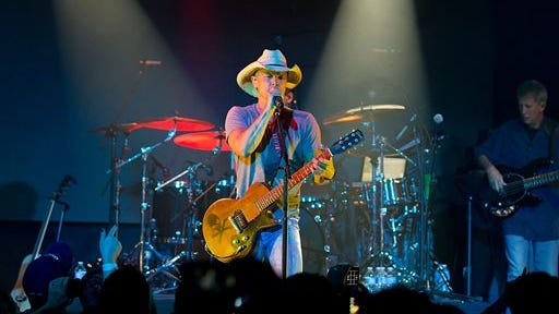 "This May 1, 2013 photo released by SiriusXM shows country singer Kenny Chesney performing at a private concert at the Highline Ballroom in New York to kick off ""SiriusXM Sounds of Summer. Chesney's newest album ""Life on a Rock,"" was released this week."