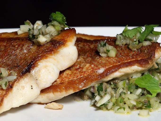 Coal-fired fish of the day with caper-fennel relish