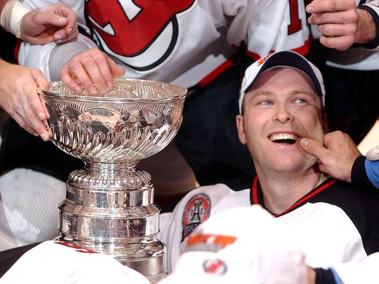 New Jersey Devils goalie Martin Brodeur gets his cheek pinched  after the Devils defeated the Anaheim Mighty Ducks 3-0 in Game 7 of the Stanley Cup Finals Monday, June 9, 2003 in East Rutherford, NJ. (AP Photo/Charles Krupa)