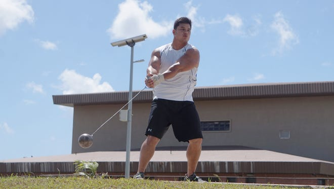 Guam national track and field team member Justin Andre trains on the hammer throw at the Dededo sports complex. Andre will be will be competing at the 2016 Micronesian Championships in Pohnpei, FSM.