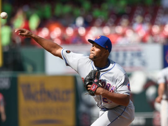 New York Mets relief pitcher Jeurys Familia (27) pitches against the St. Louis Cardinals during the eleventh inning at Busch Stadium.