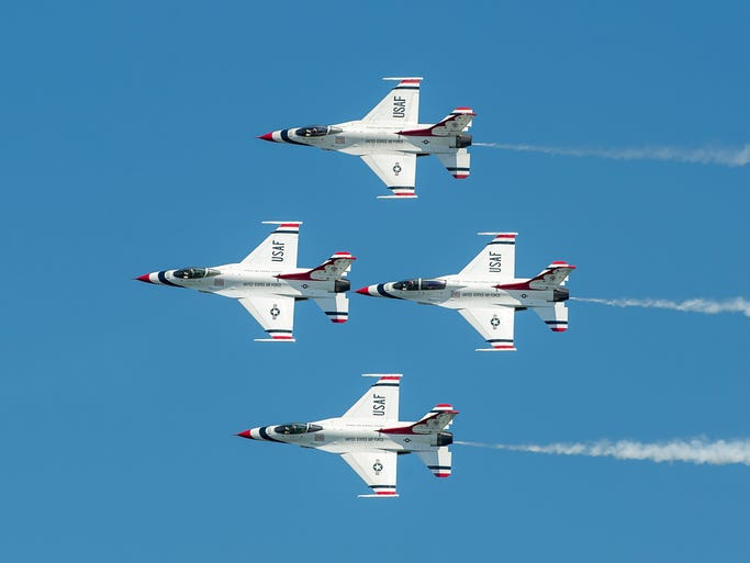 U.S. Air Force Thunderbirds fly in formation during their performance in the OC Air Show. The show includes acrobatics and formations by civilian and military aircraft, including the GEICO Skytypers and a U.S. Marine Corps AV-8B Harrier demo. The OC Air Show continues Sunday, with show center at 16th Street oceanside.