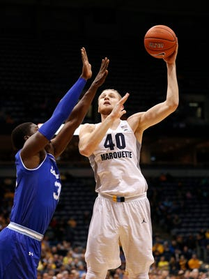 Marquette Golden Eagles center Luke Fischer (40) shoots during the first half against the Seton Hall Pirates at BMO Harris Bradley Center.