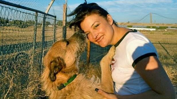 Whiskers and Amy Konstantelos before the dog was sent to RRR Service Dogs in Tennessee. She's now afraid her dog is probably dead.