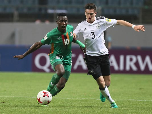 Germany's Dominik Schad, right, fights for the ball against Zambia's Fashion Sakala, left, during the round of 16 soccer match in the FIFA U-20 World Cup Korea 2017 at Jeju World Cup Stadium in Jeju, South Korea, Wednesday, May 31, 2017. (Park Ji-ho/Yonhap via AP)