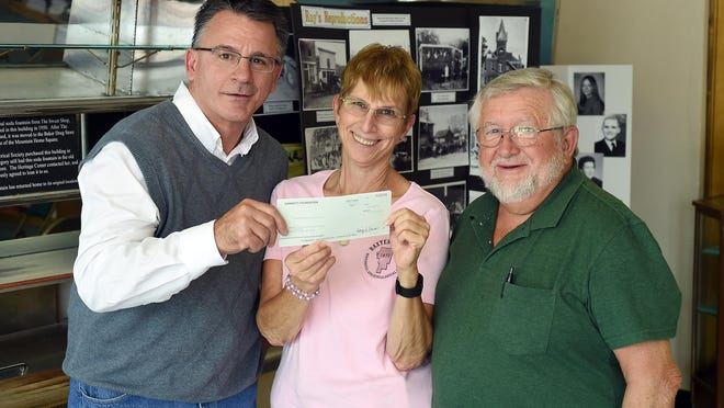 Bob Heist, left, The Baxter Bulletin managing editor, presents $1,000 to Jennifer Baker and David Benedict of the Baxter County Historical & Genealogical Society. The donation was made through the Gannett Foundation, the charitable arm of The Bulletin's parent company, Gannett Co.