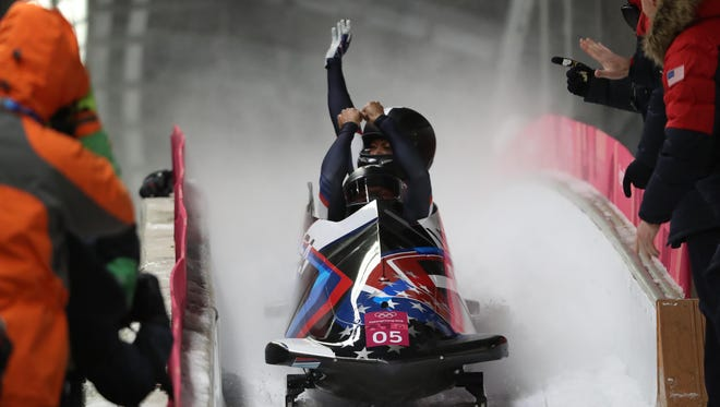 Elana Meyers Taylor and Lauren Gibbs of the USA celebrate after the fourth run of the women's bobsled, securing a silver medal.