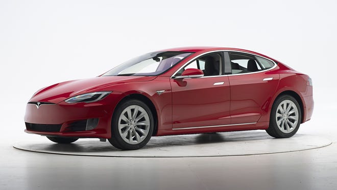 This Sept. 7, 2016, photo provided by the Insurance Institute for Highway Safety shows a Tesla Model S before crash safety testing. The car earned good ratings in four of the institute's five tests, but fell short of getting the highest safety rating in the newest crash tests administered by the insurance industry.