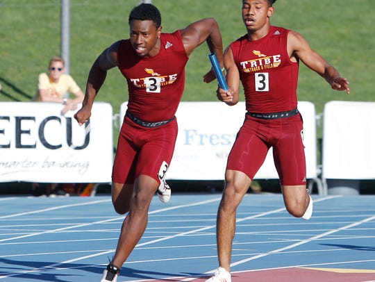 Randy Jordan of Tulare Union hands off to RayVaugh Gordon in the 4 x 100 meter relay event at the CIF Track and Field Championships at Buchanan High School Saturday, June 2, 2018 in Clovis, Calif.