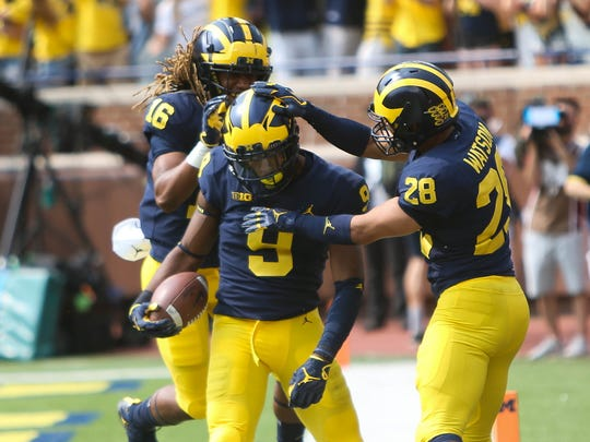 Michigan's Donovan Peoples-Jones (9) celebrates his 79-yard touchdown in the third quarter against Air Force with Jaylen Kelly-Powell, left, and Brandon Watson, Saturday, Sept. 16, 2017 at Michigan Stadium.