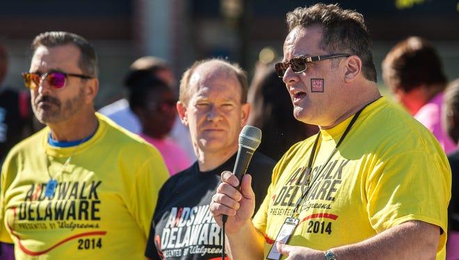 John Gardner speaks before the start of the 2014 Delaware AIDS Walk while still serving as interim executive director.