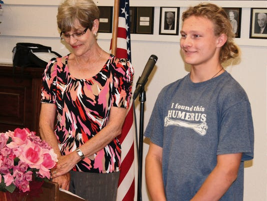 Skyler Blood-Raiter, a junior at Aldo Leopold High School, is recognized as March Student of the Month by the Silver City Kiwanis Club on Tuesday, while Kiwanian Kari Scullion, left, looks on. Eleven students were recognized at the luncheon, which was held at the Masonic Lodge. Randal Seyler - Sun-News