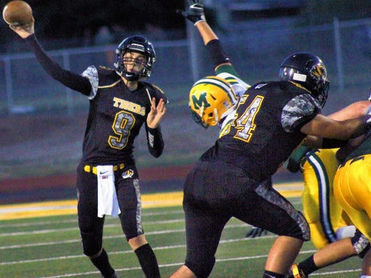 Kyle Hooper throws a pass Friday night at Tiger Stadium. Hooper threw for 408 yards and scored four touchdowns.