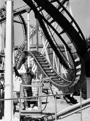1990: Charlie Johnson of Seaside Heights paints one of the pillars for the Shockwave at Great Adventure.