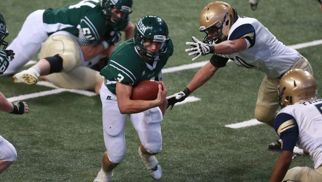 Pella quarterback Noah Clayberg scampers into the red zone against Sioux City Heelan in the Class 3-A state football championship game on Thursday, Nov. 20, 2014, at the UNI-Dome in Cedar Falls.