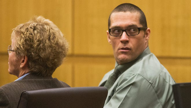 Bryan Wayne Hulsey looks around as the jury convicts him of first-degree murder and attempted first degree murder in Maricopa County Superior Court, Monday, July 28, 2014.