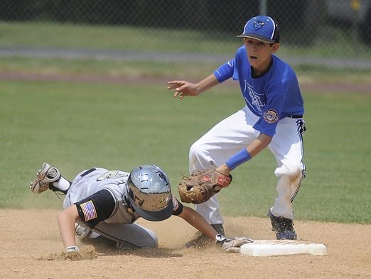 Mountain Home shortstop Josh Prinner tries to apply a tag to an Andrews, Texas, baserunner.