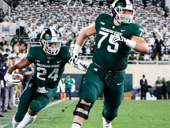 MSU OG Kevin Jarvis paves the way for a Gerald Holmes