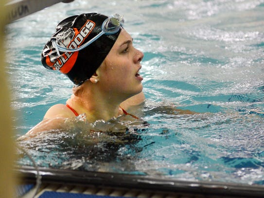Lillie Hosack of Cedarburg glances at the scoreboard after winning the 100 butterfly at the Bulldog Invite girls swim meet Sept. 30 at Cedarburg High School.