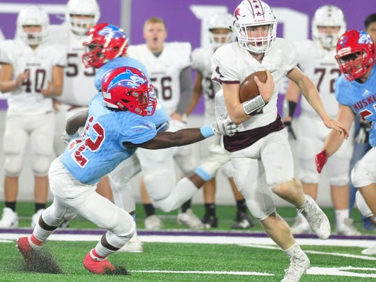 Brownwood quarterback Tommy Bowden runs through a tackle by Wichita Falls Hirschi defensive back Stavonte Vaughn during the first half of the Lions Region I-4A bi-district playoff game this past season at Abilene Christian University's Wildcat Stadium.